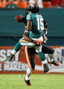 Danieal Manning separates the ball from Miami's Davone Bess