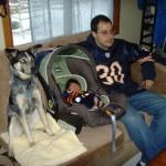 Ben, Maya, and Bandit watching the game