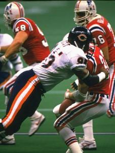 Richard Dent causing a fumble in Super Bowl XX